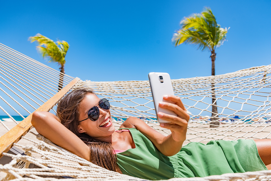 Summer beach lifestyle young woman using phone app