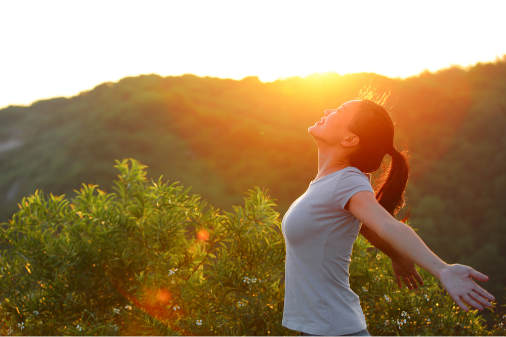 Woman stretching outdoors as the sun sets